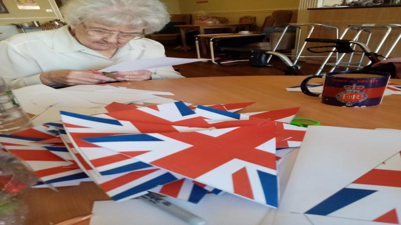 Bunting making for queens Birthday afternoon Tea